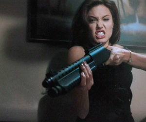 Angelina Jolie, actress, and gun image