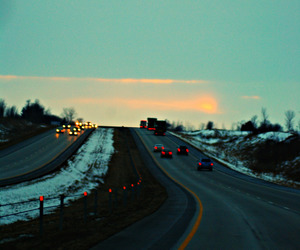road, sky, and car image