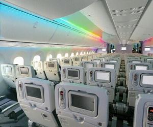 airplane and rainbow image