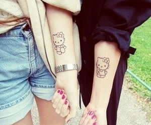 girl, hello kitty, and tattoo image