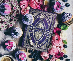book, cupcake, and flowers image