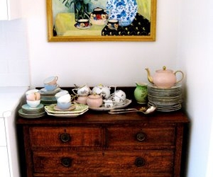 teacups, teapot, and stacked cups image