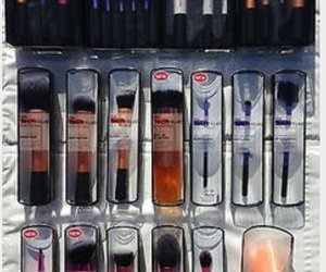 Brushes, eye makeup, and lips image