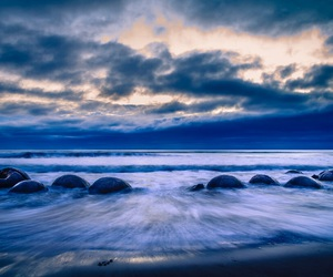 beach, moeraki, and boulders image
