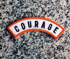 badge, courage, and granite image