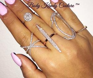 knuckle ring, open ring, and art deco rings image