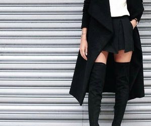 white t-shirts, black thigh high boots, and long black coat image