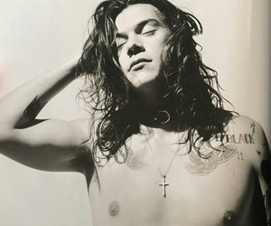 Harry Styles, one direction, and another man magazine image