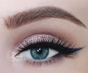 eye lashes, eyeliner, and lipstick image