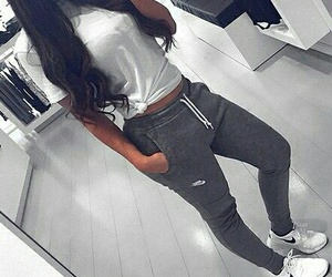 nike sneakers, long wavy brown hair, and white t-shirts image