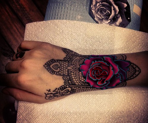 hands, rose, and henna image