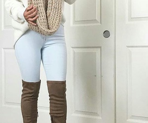 infinity scarf, white knit sweater, and light blue skinny jeans image
