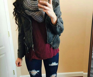 black leather jacket, long wavy black hair, and dark blue ripped jeans image