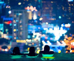 city, lights, and swimingpool image