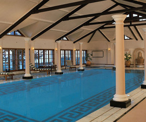 indoor pool, luxury, and wealth image