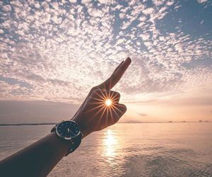 sun, sky, and sea image