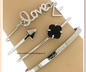 bangles, lucky clover, and bracelets image