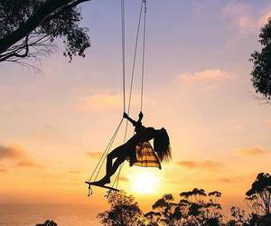 sunset and swing image