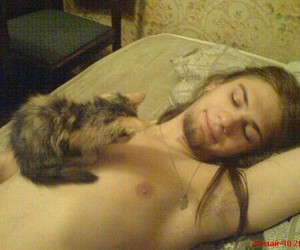 cat and long haired guy image