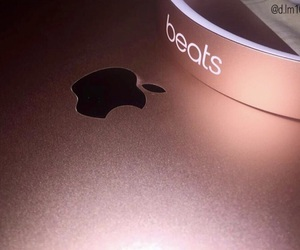 rose gold, apple, and laptop image
