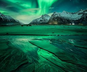 green and northern lights image