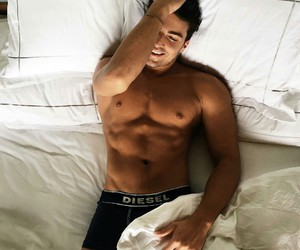 black underwear, handsome, and pillows image