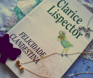 book, necklace, and clarice lispector image