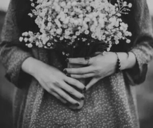 black and white, hands, and flowers image