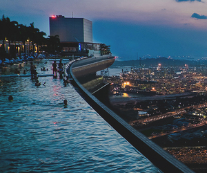 city, pool, and night image