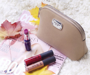 beauty, essentials, and makeup bag image