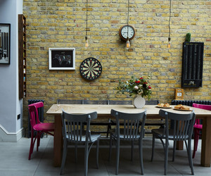 dining room, home, and exposed brick image