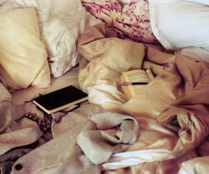 bed, book, and pillow image