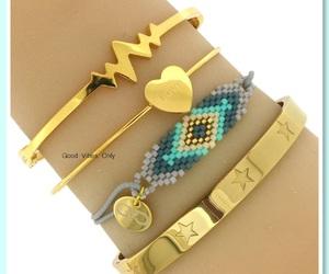 bangles, bracelets, and gold image