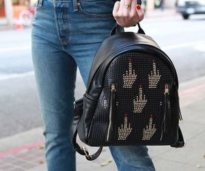 backpack and middle finger image