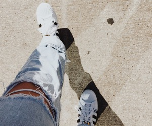 ripped jeans, white adidas, and adidas image