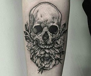 flower, forearm tattoo, and skull image