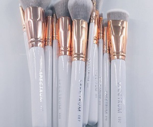 Brushes, goals, and gold image