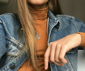 straight light brown hair, gold hoops, and blue denim jacket image