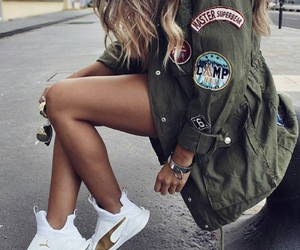 silver bracelets, green jackets, and long wavy blonde hair image