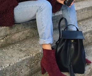light blue jeans, black backpack, and burgundy ankle booties image