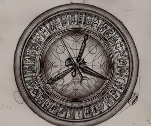 alethiometer, book, and compass image