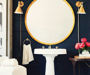 gold accents, navy walls, and bathroom image