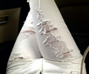 white ripped jeans image