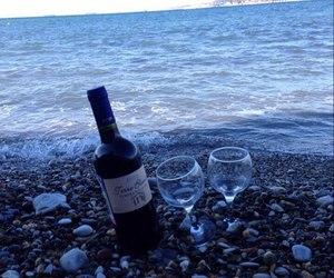 sea, wine, and beach image