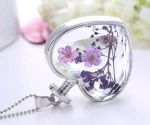flower, flower petal, and necklace image
