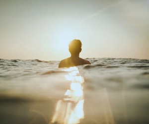 sea, boy, and light image