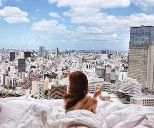 city, girl, and bed image