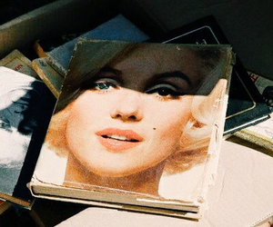 Marilyn Monroe, book, and vintage image