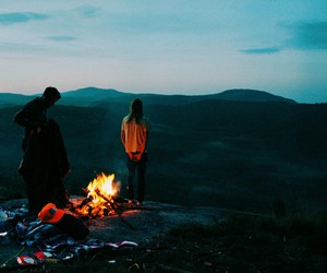 fire, couple, and mountains image