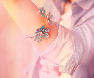 bracelet and flowers image